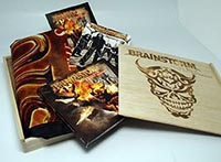 On The Spur Of The Moment wooden fan box with the digipak CD, a big poster flag with the cover artwork, a signed autograph card and a Brainstorm sticker (limited to 666 copies only)